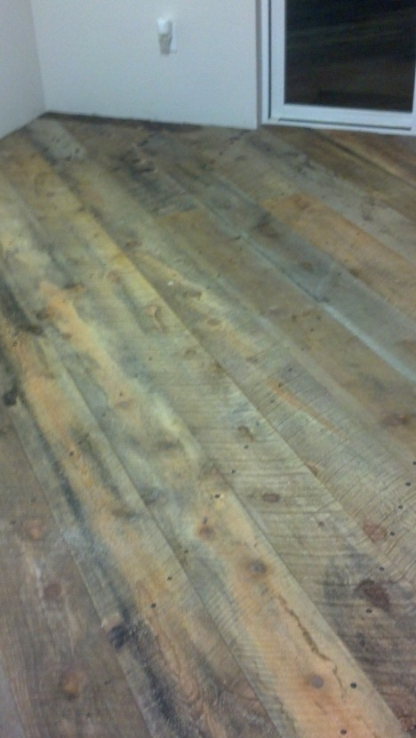 Wooden barn board floor before the application of Epoxy.com product #15